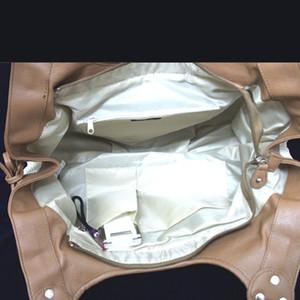 サイドのリボンがアクセントのラメメッシュバッグ